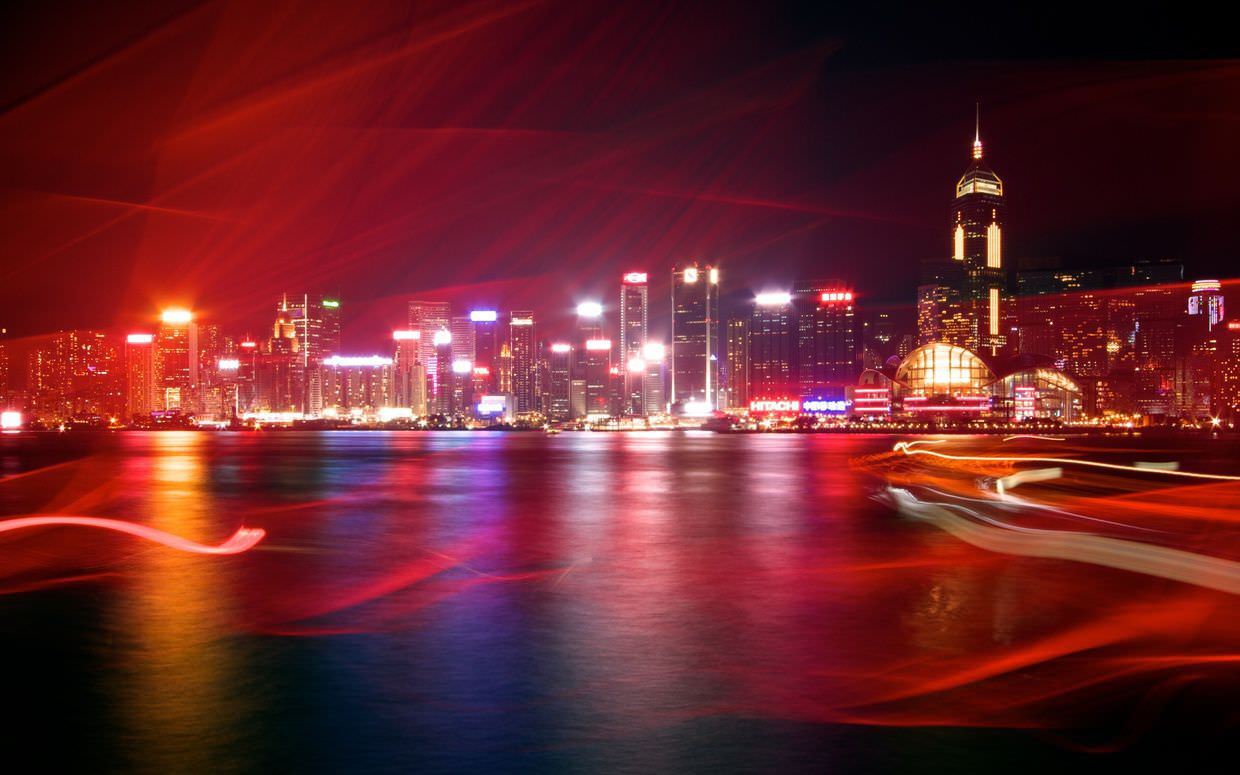 A long exposure of Hong Kong as an old red-sailed galleon passes close by