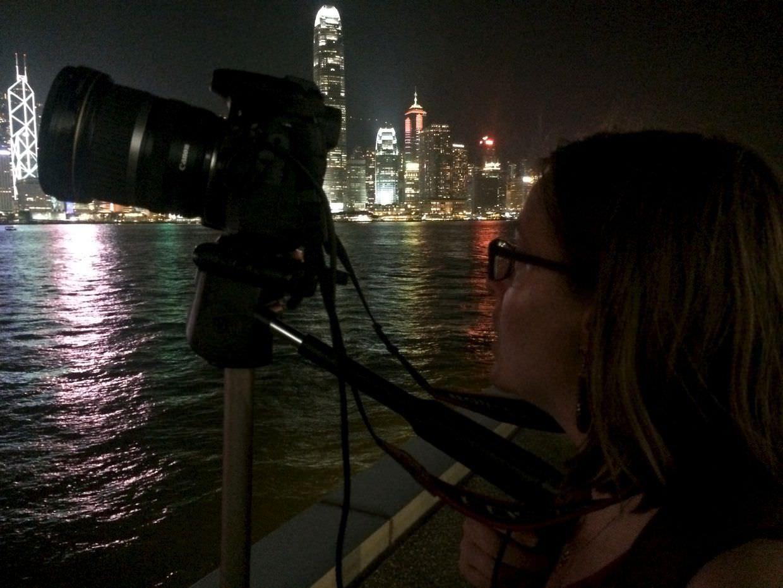 Samantha, a tripod and the Hong Kong skyline