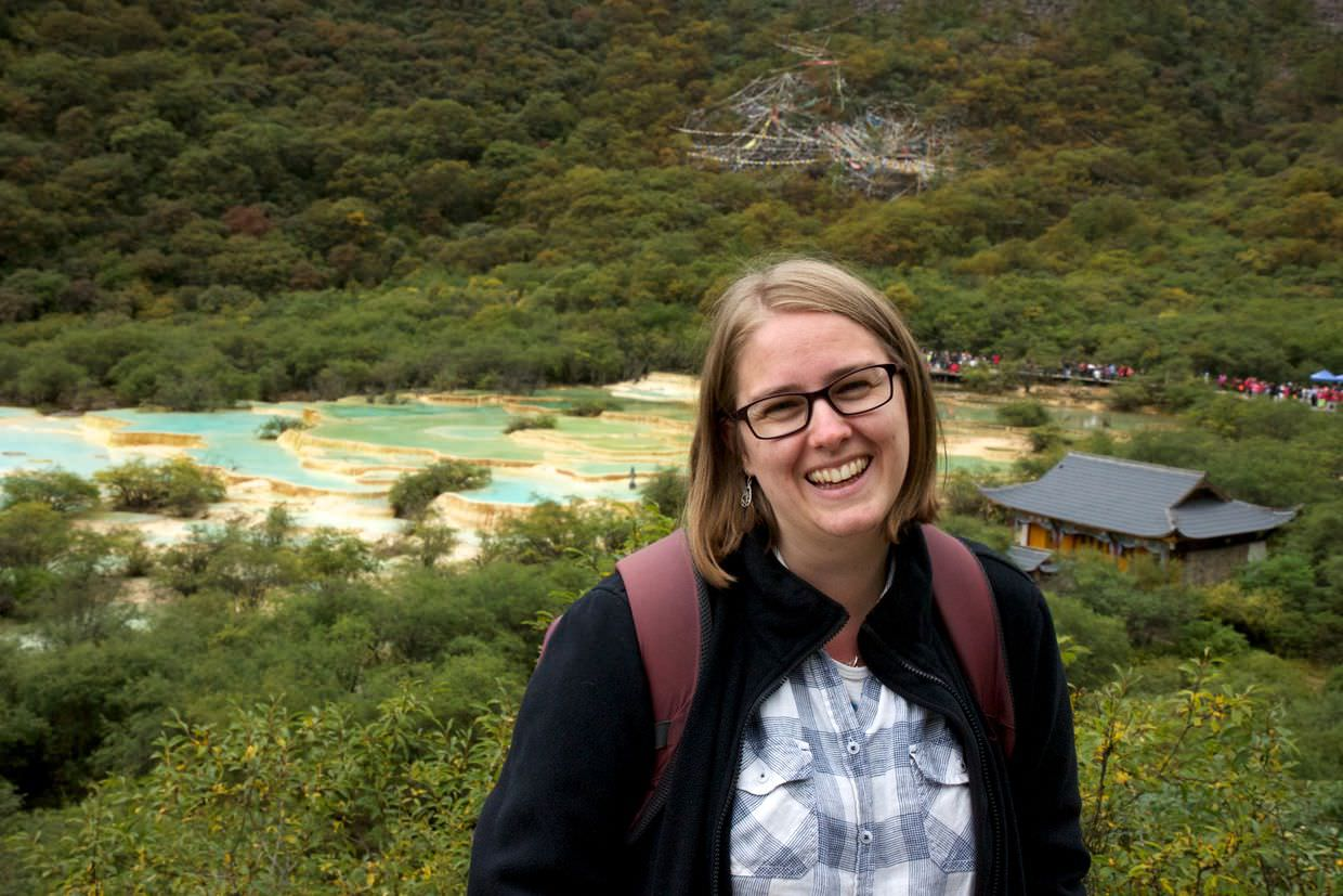 Samantha and the multi-coloured pond at the top of Huanglong park