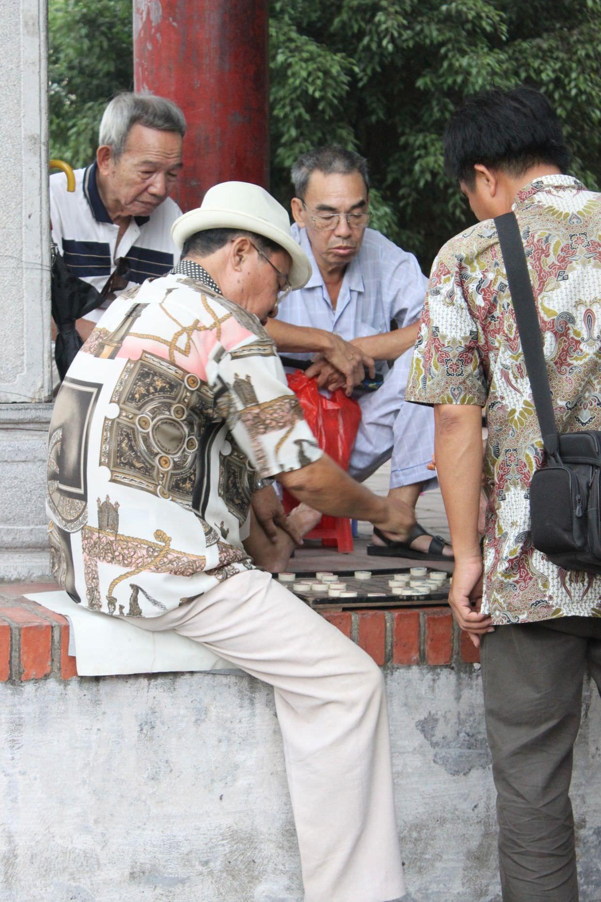 Playing Mahjong at Ngoc Son temple