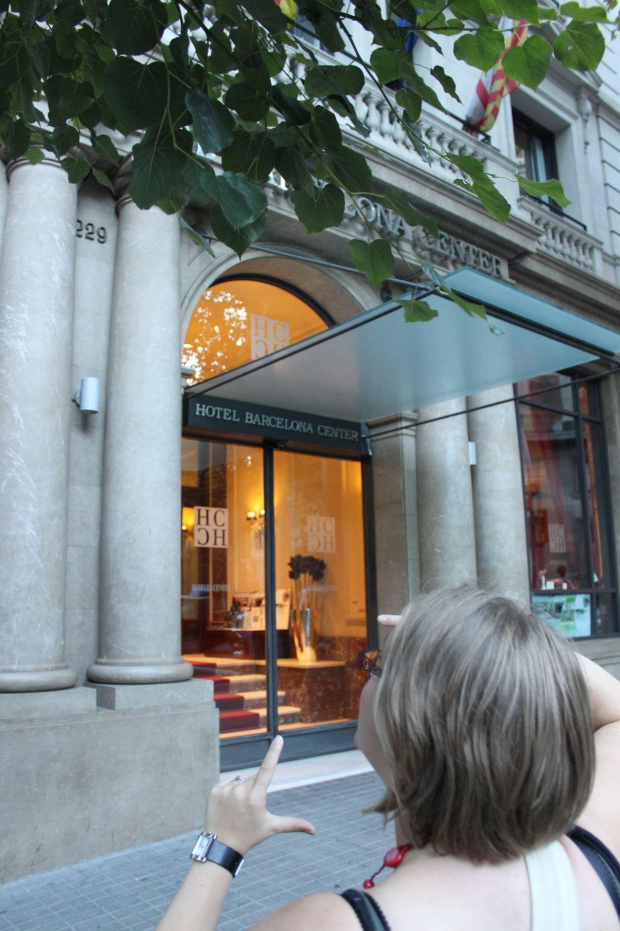 Samantha explaining the photograph I should take outside Hotel Center