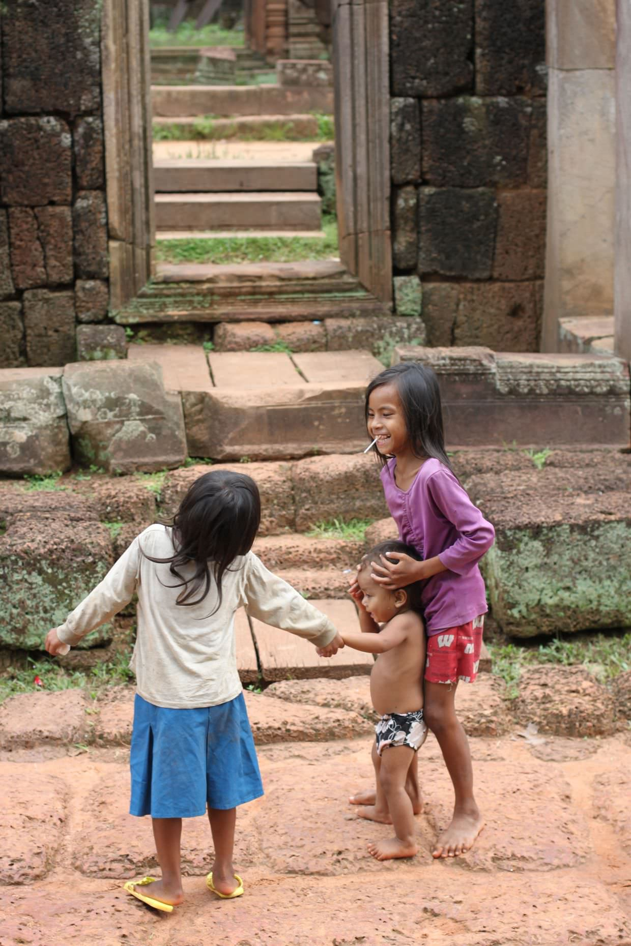Children playing at the temple