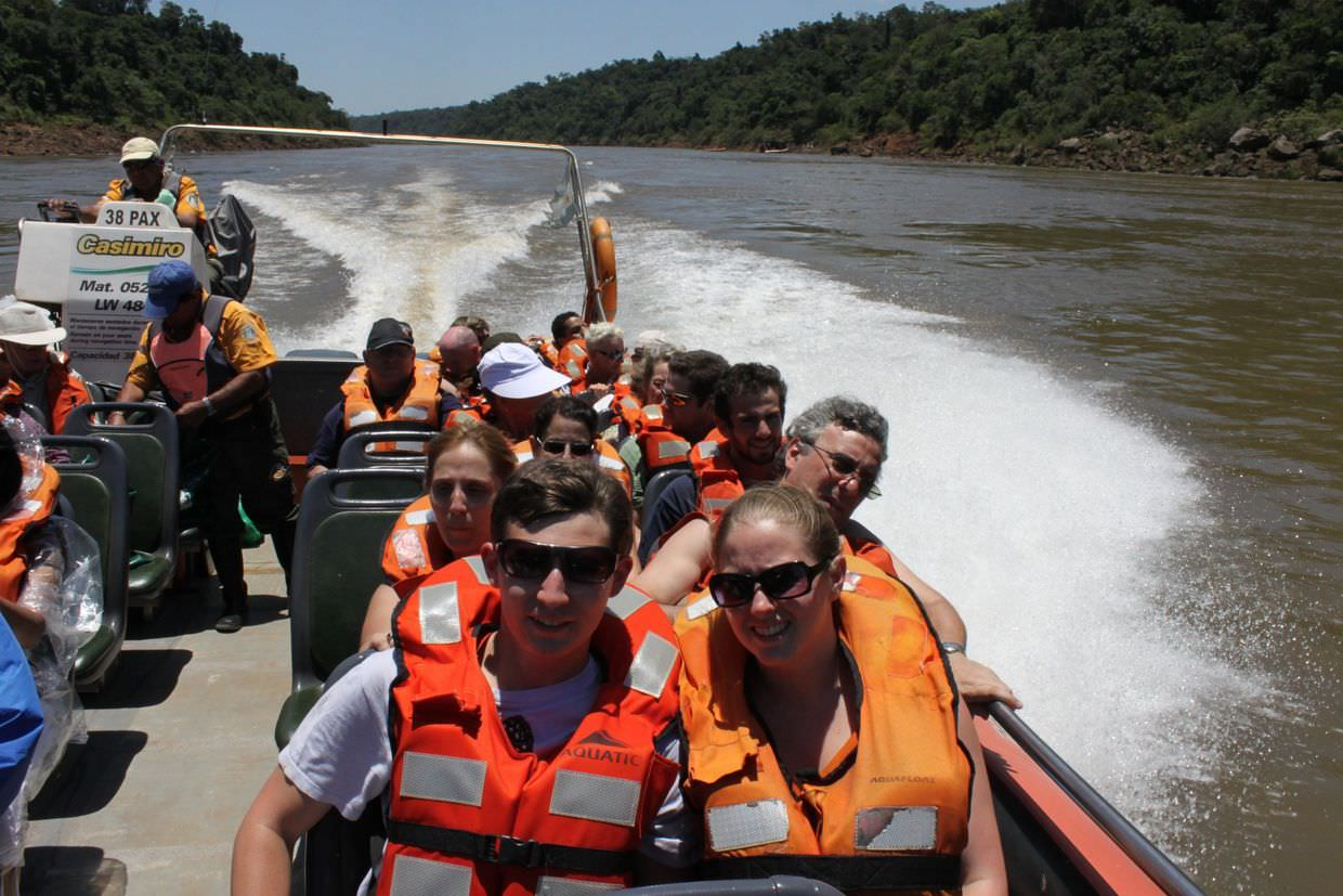 Sam and Paul on a boat, heading out to the waterfalls