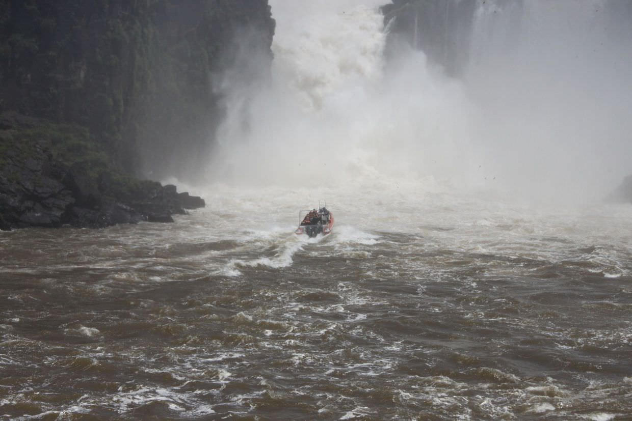 A boat about to pass under one of the falls