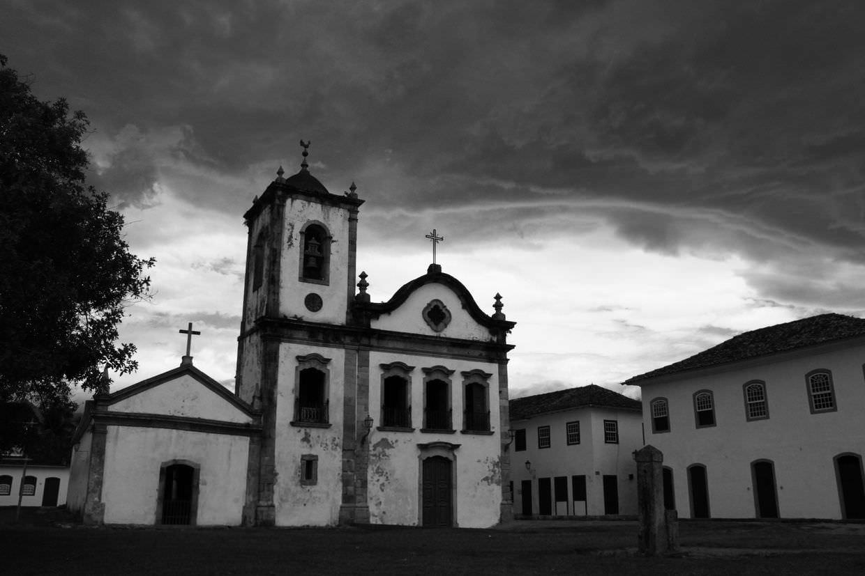 Igreja Santa Rita beneath incoming storm