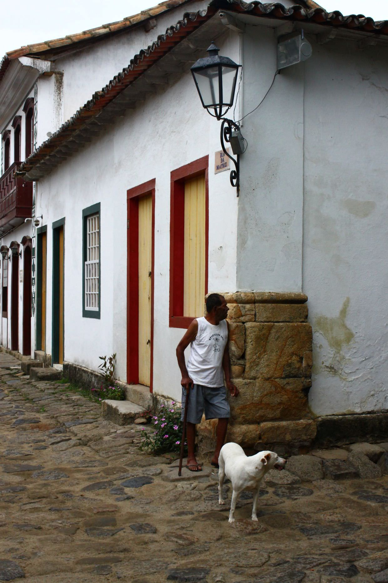 Resident and dog in Paraty