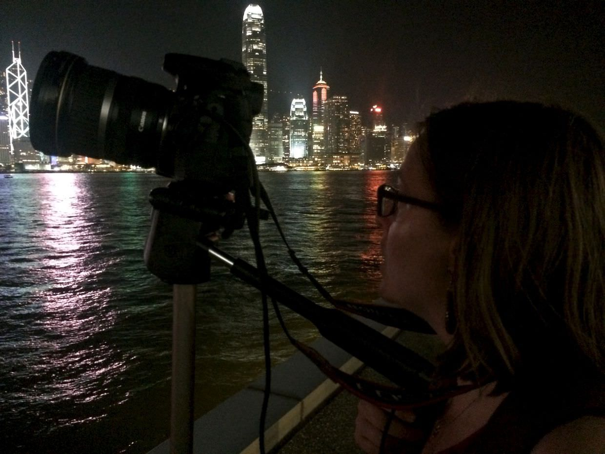 Samantha, a tripod and the Hong Kong skyline