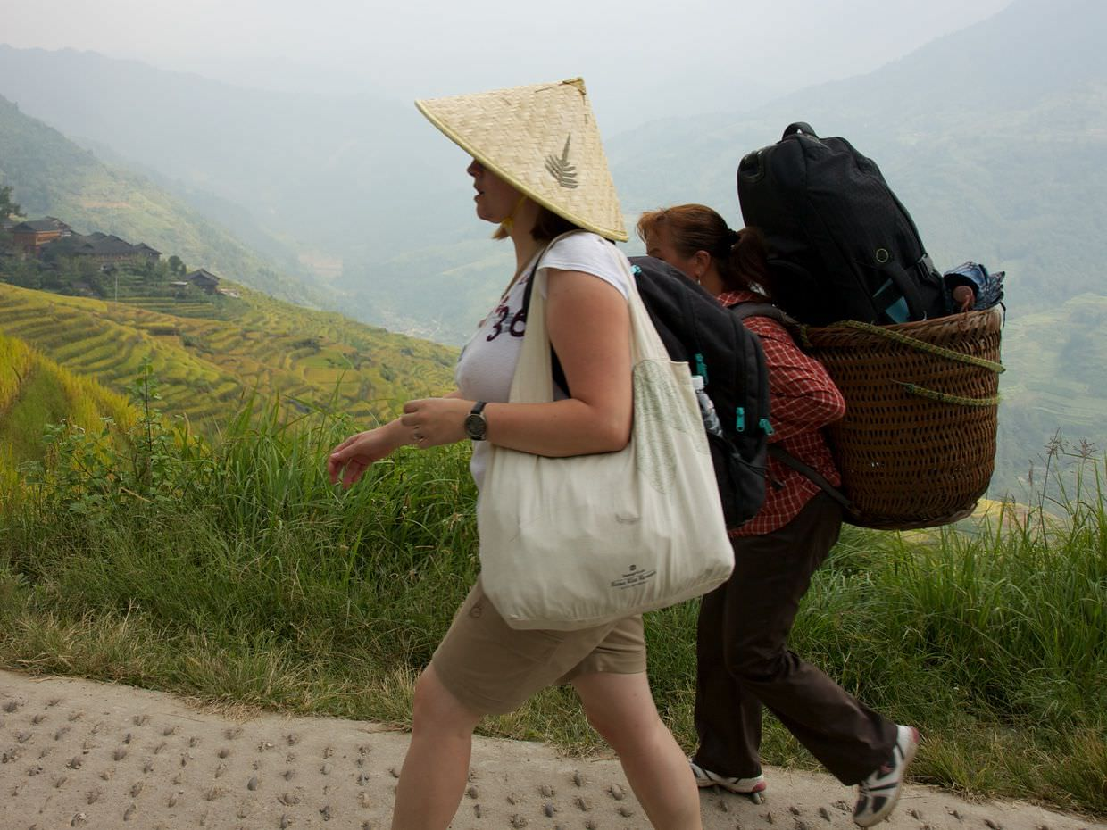 Samantha and one of our bag carriers, hiking up to Ping'an