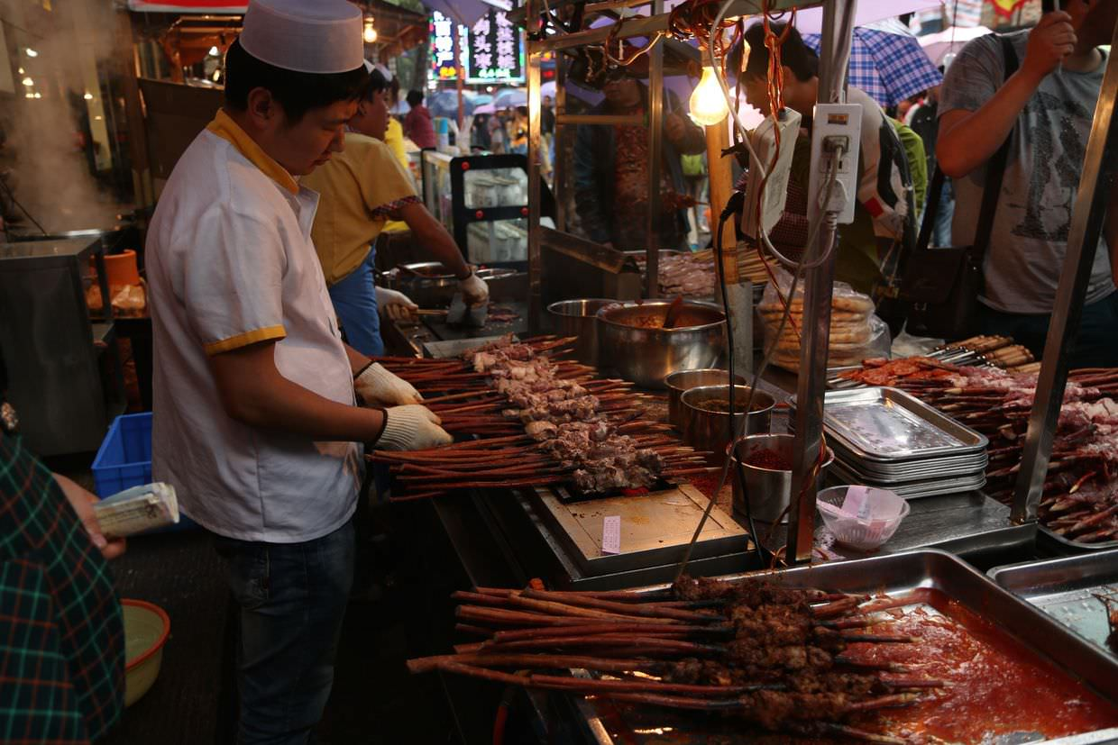 Street-food vendor in Xi'an's Muslim quarter. Meat on a stick.