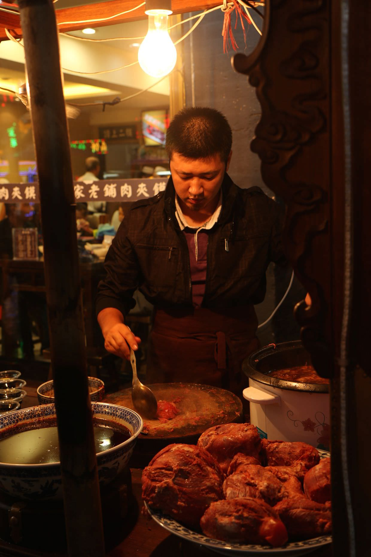 Street-food vendor making our first Rou jia mo, or Chinese hamburger