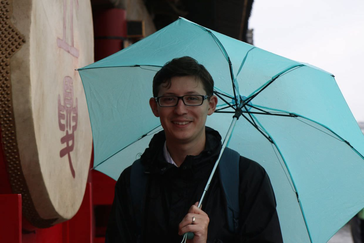 Paul in the rain outside the drum tower