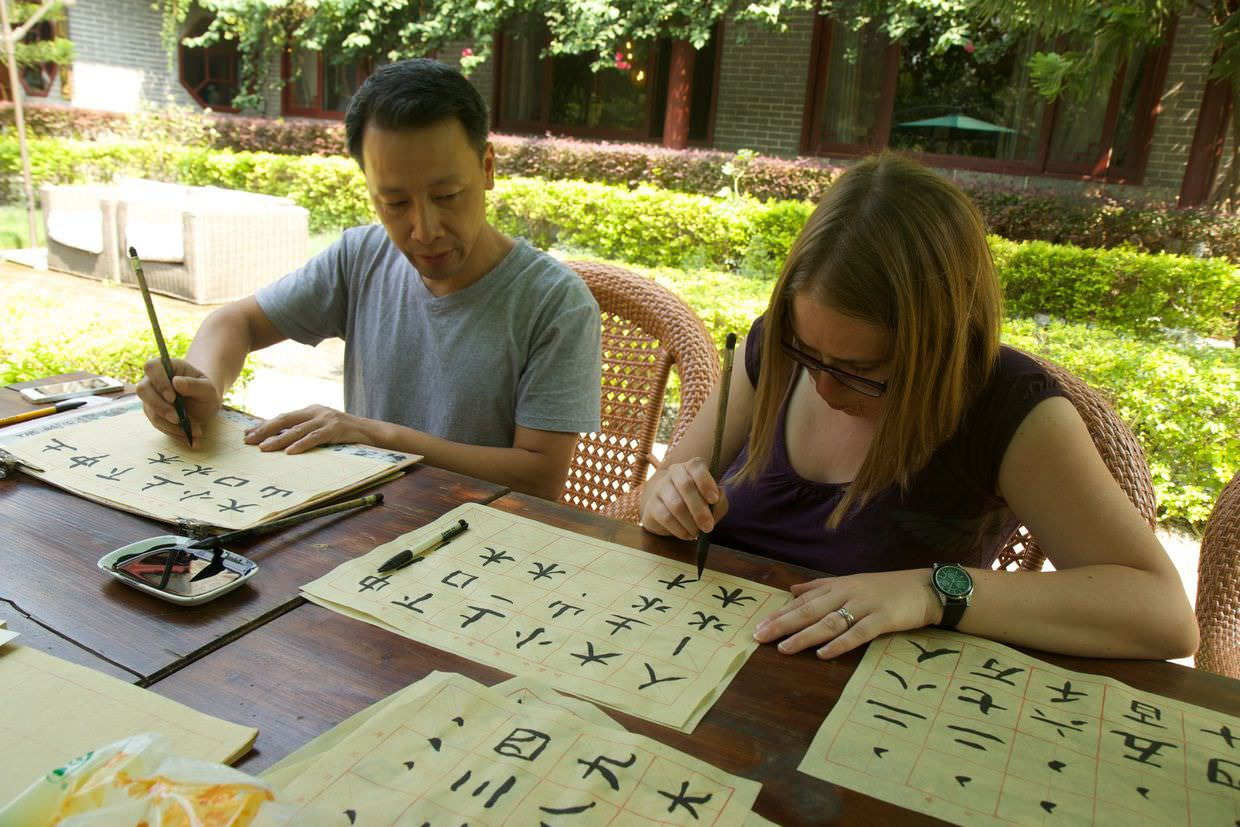Samantha learning Chinese calligraphy