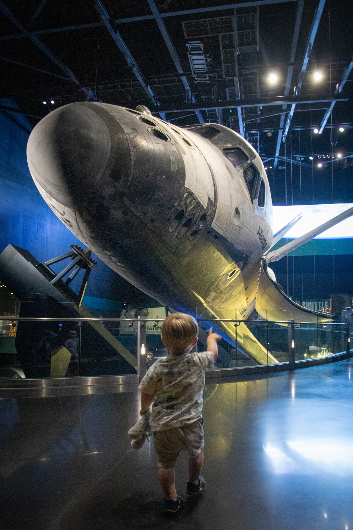 Conway, teddy bear in hand, seeing Space Shuttle Atlantis