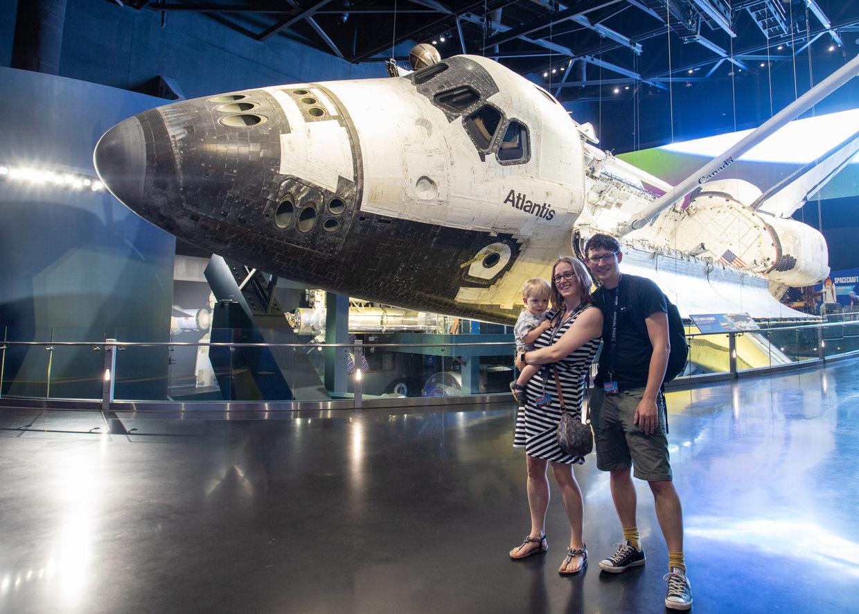 The family besides Space Shuttle Atlantis