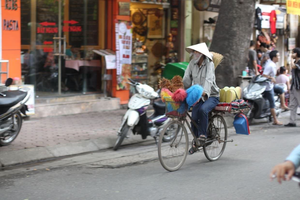 A street vendor, selling cleaning products as she goes