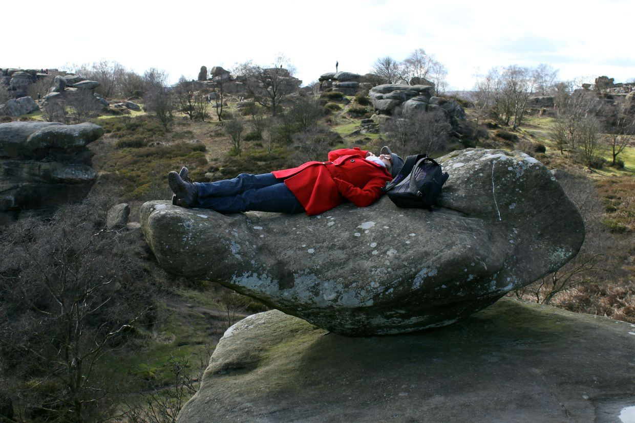 Reclining on the rocks, chatting to mum