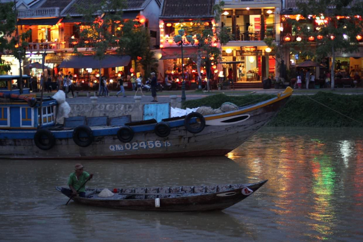 An evening on the river in Hoi An, as the rain starts