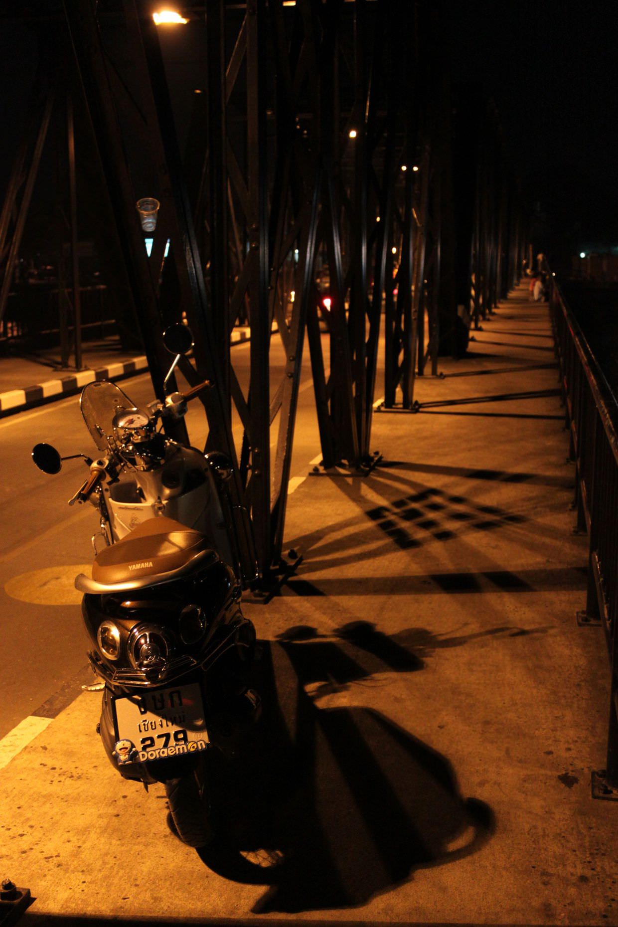 Scooter on Chiang Mai's iron bridge
