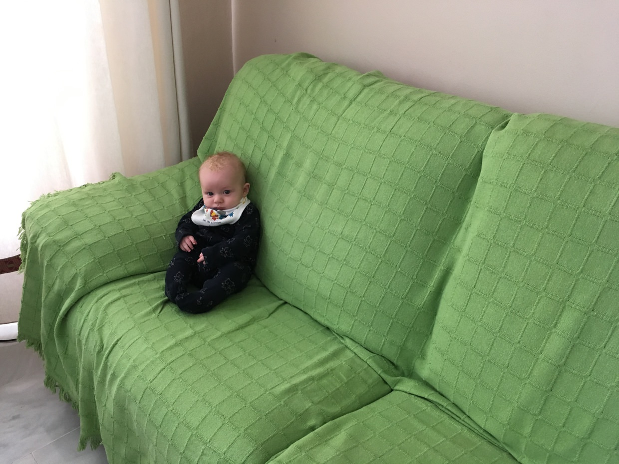 Conway looking tiny and cure on Amanda's sofa