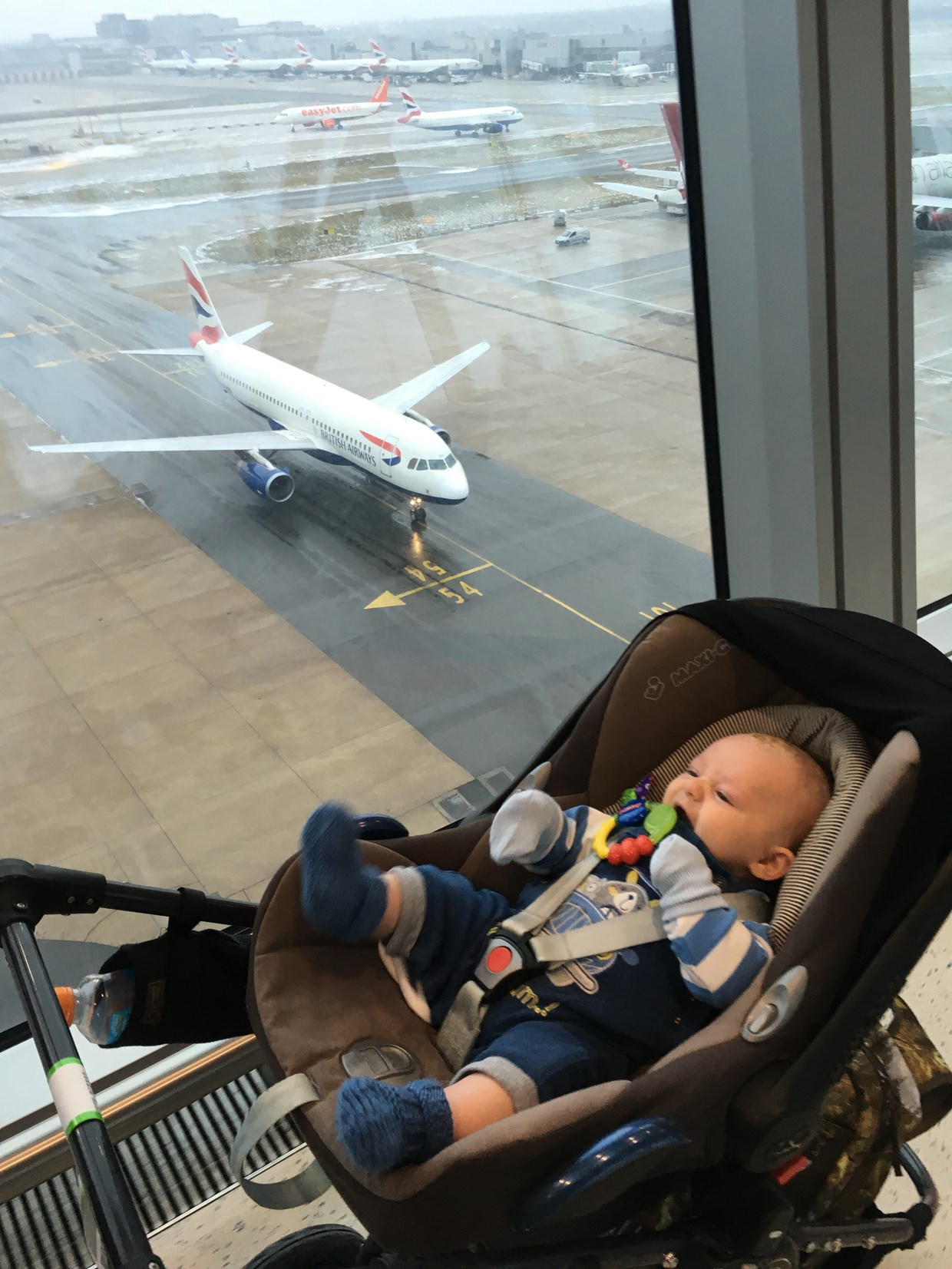 """We're doing this!"", Conway about to board a plane at 3 months old"