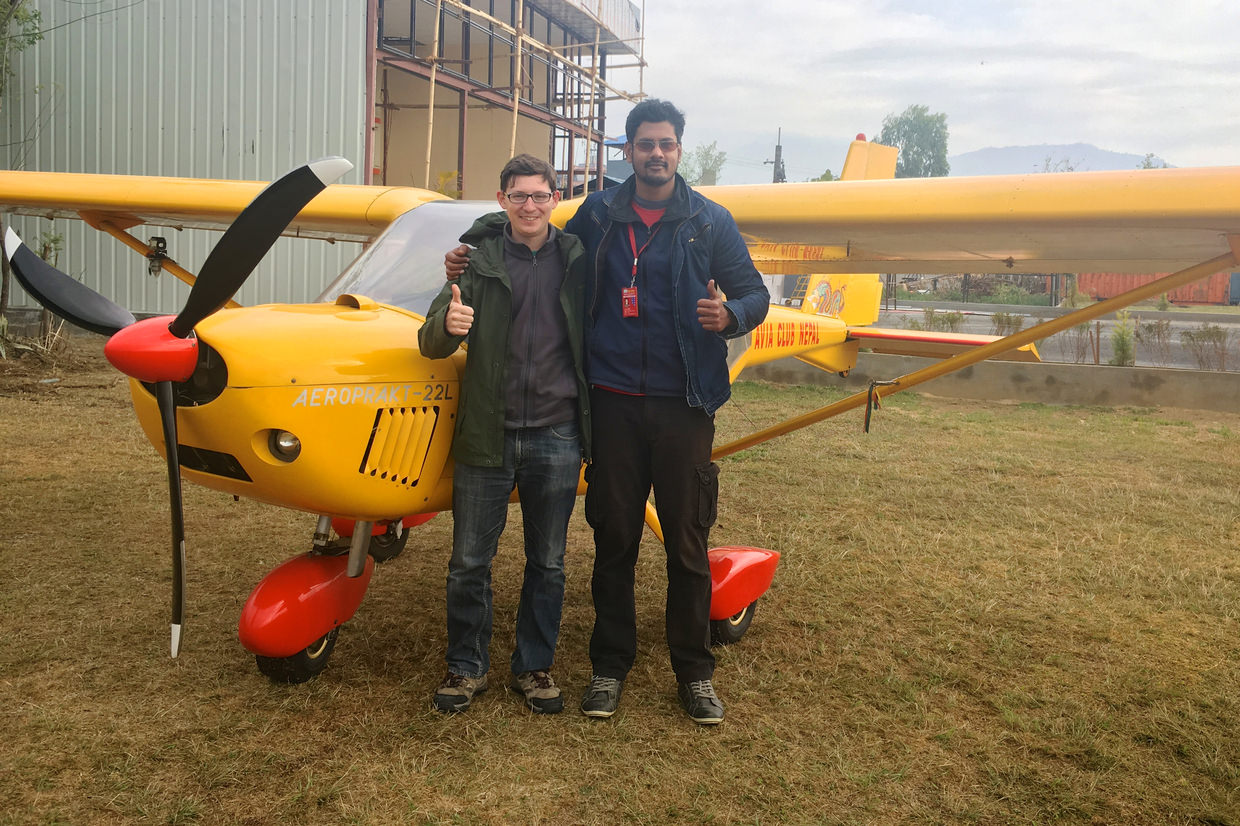 Paul and pilot Manoj with the yellow ultralight