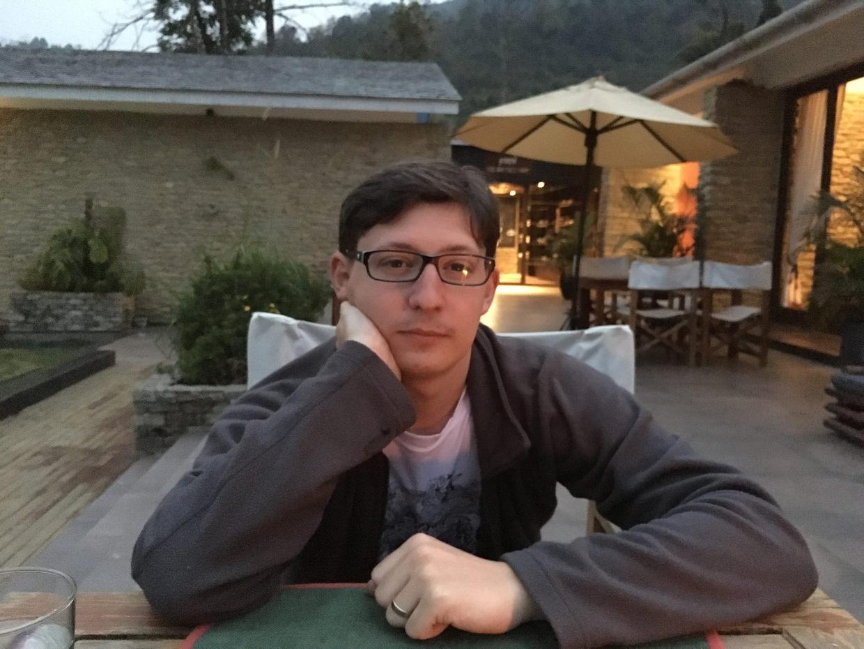 Paul chilling outside Pavilion's restaurant the night before our trek