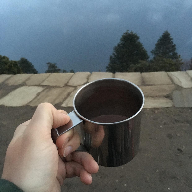 Enjoying hot chocolate, minus the views