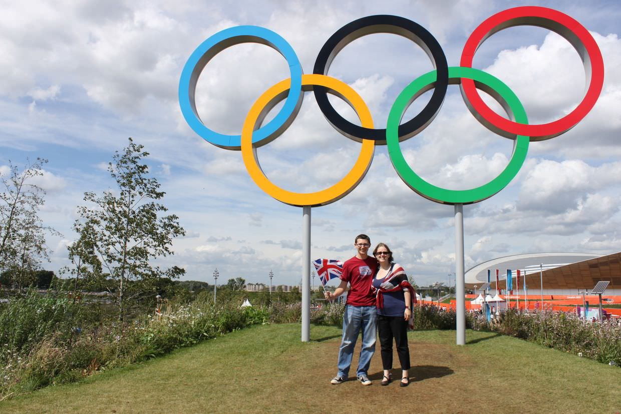 Paul and Sam beneath the olympic rings