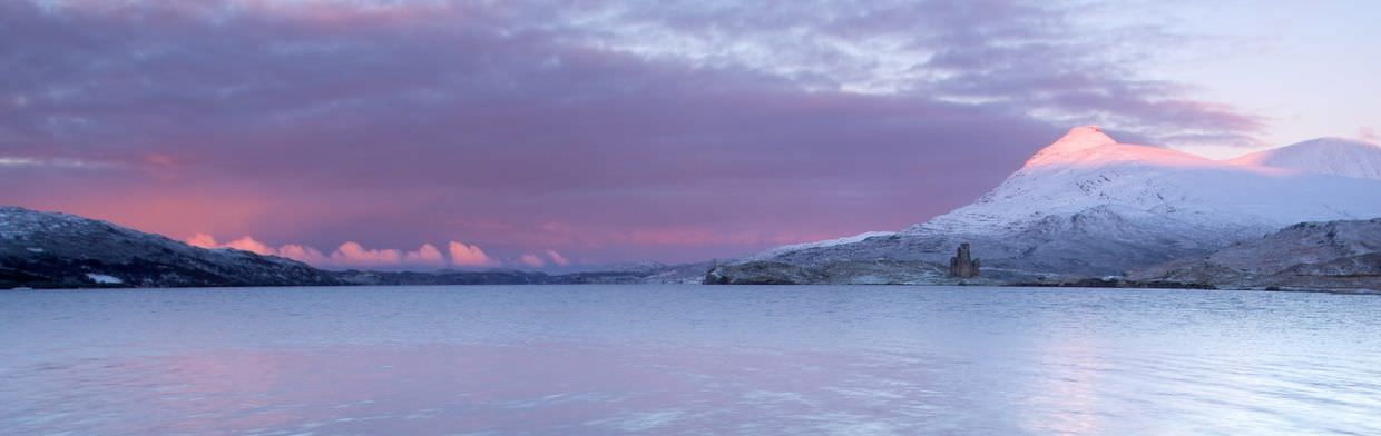 Loch Assynt and Ardvreck Castle at sunrise