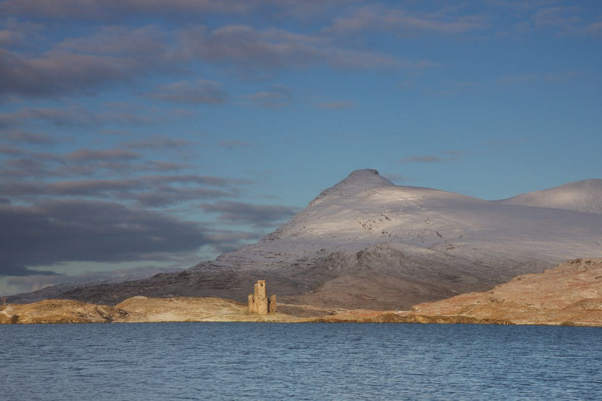 Ardvreck castle separated by light from Quinag mountain, by Samantha