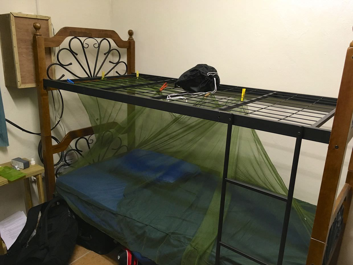 My bed in the volunteer house, with my mosquito net