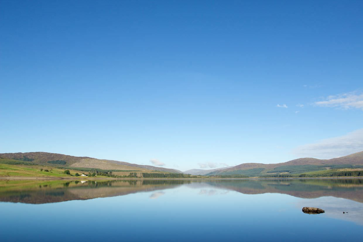 Reflections of Craigencallie on Clatteringshaws Reservoir