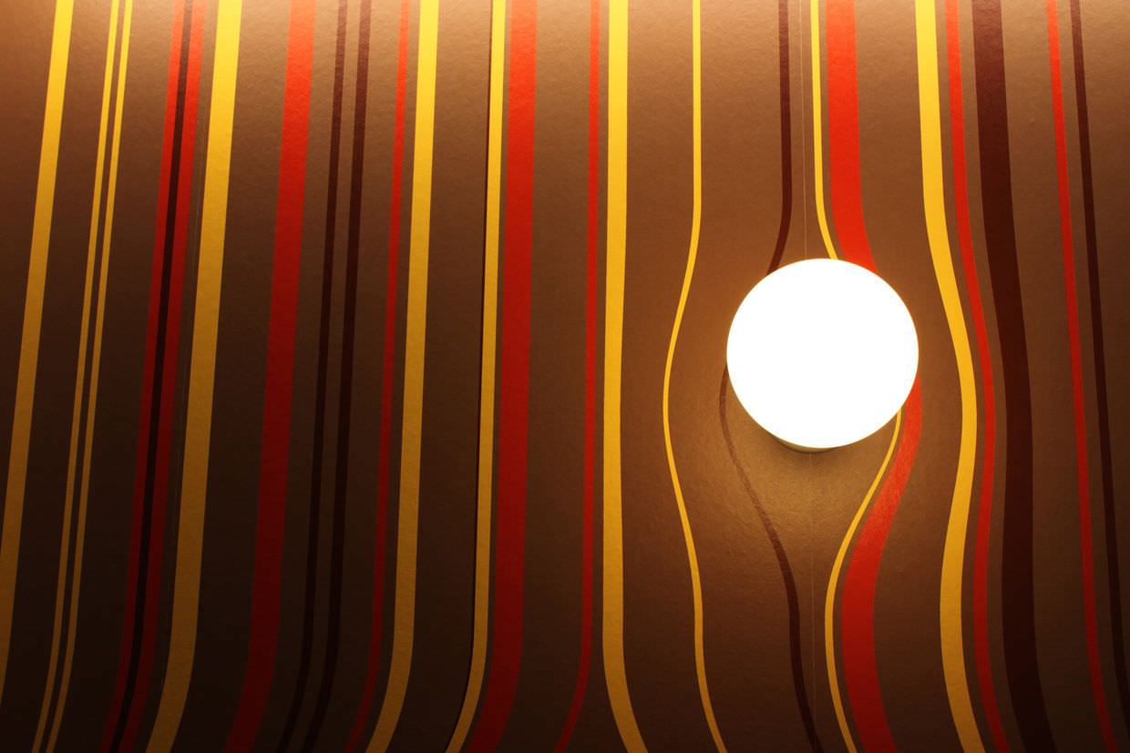Wallpaper curving around a light fitting at dHUB wallpaper exhibition