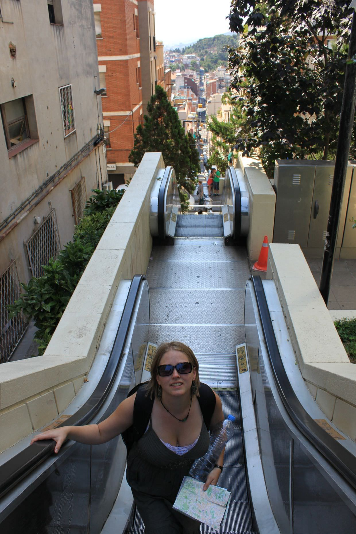 Riding outdoor escalators up to Park Güell