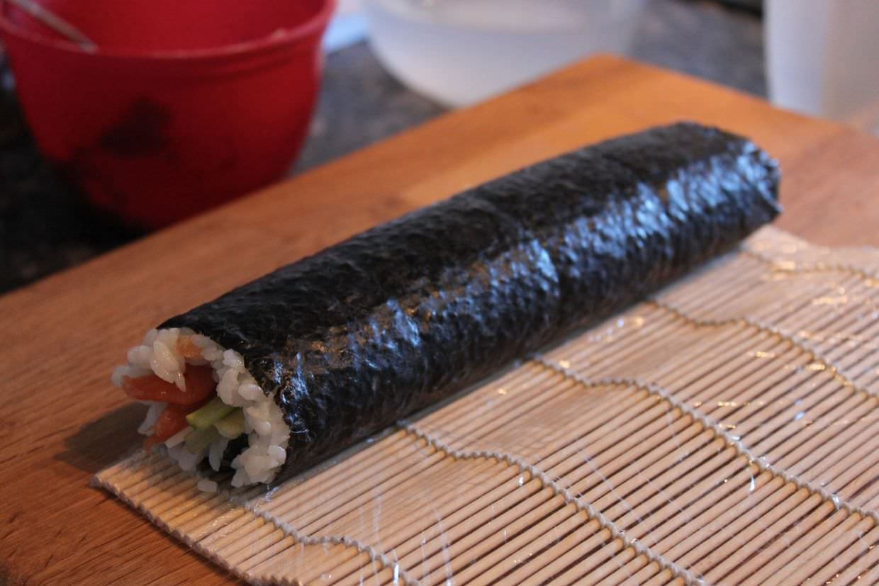 A sushi roll ready to slice