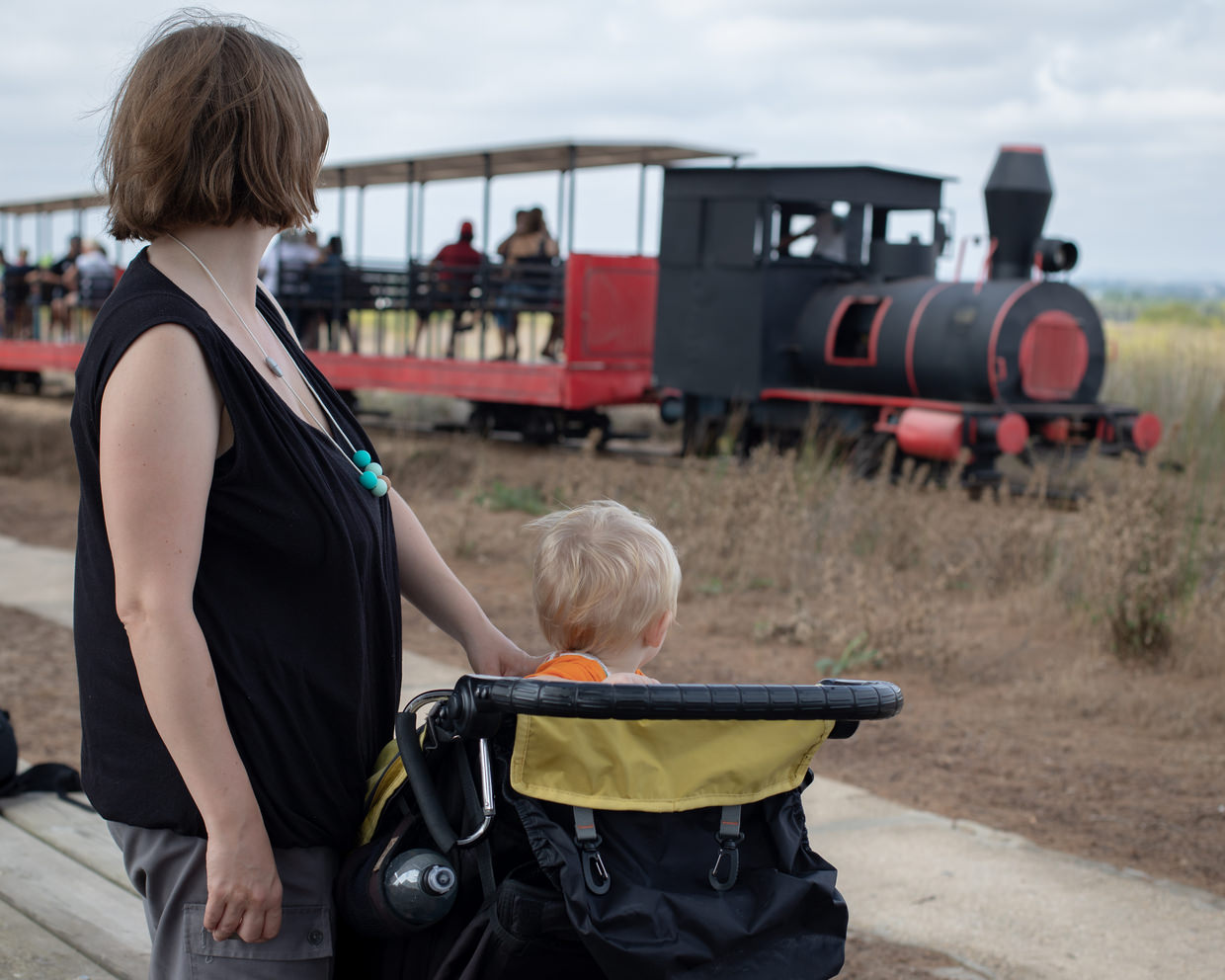 Samantha and Conway watching the small diesel train