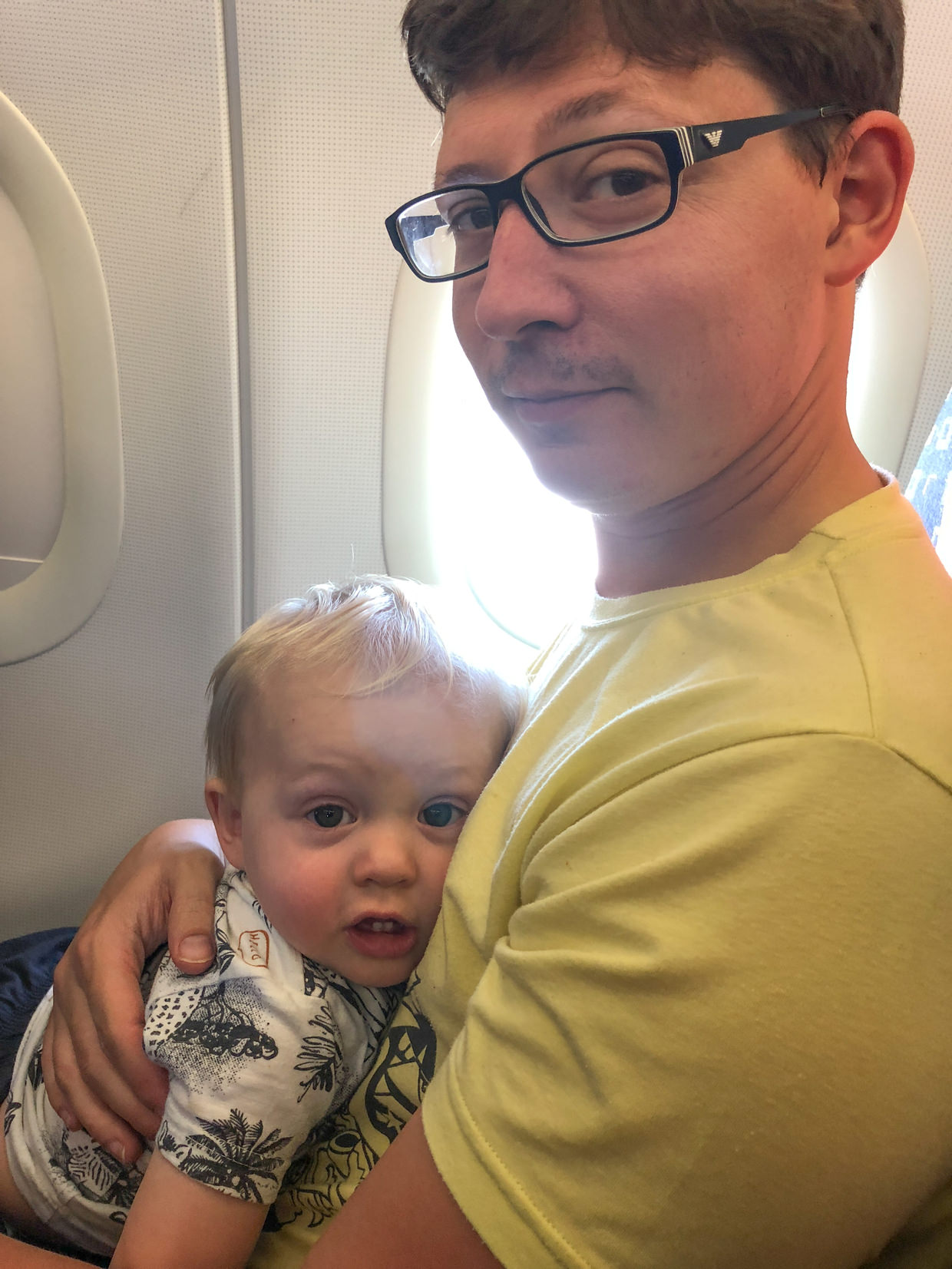 Paul and Conway on the flight home
