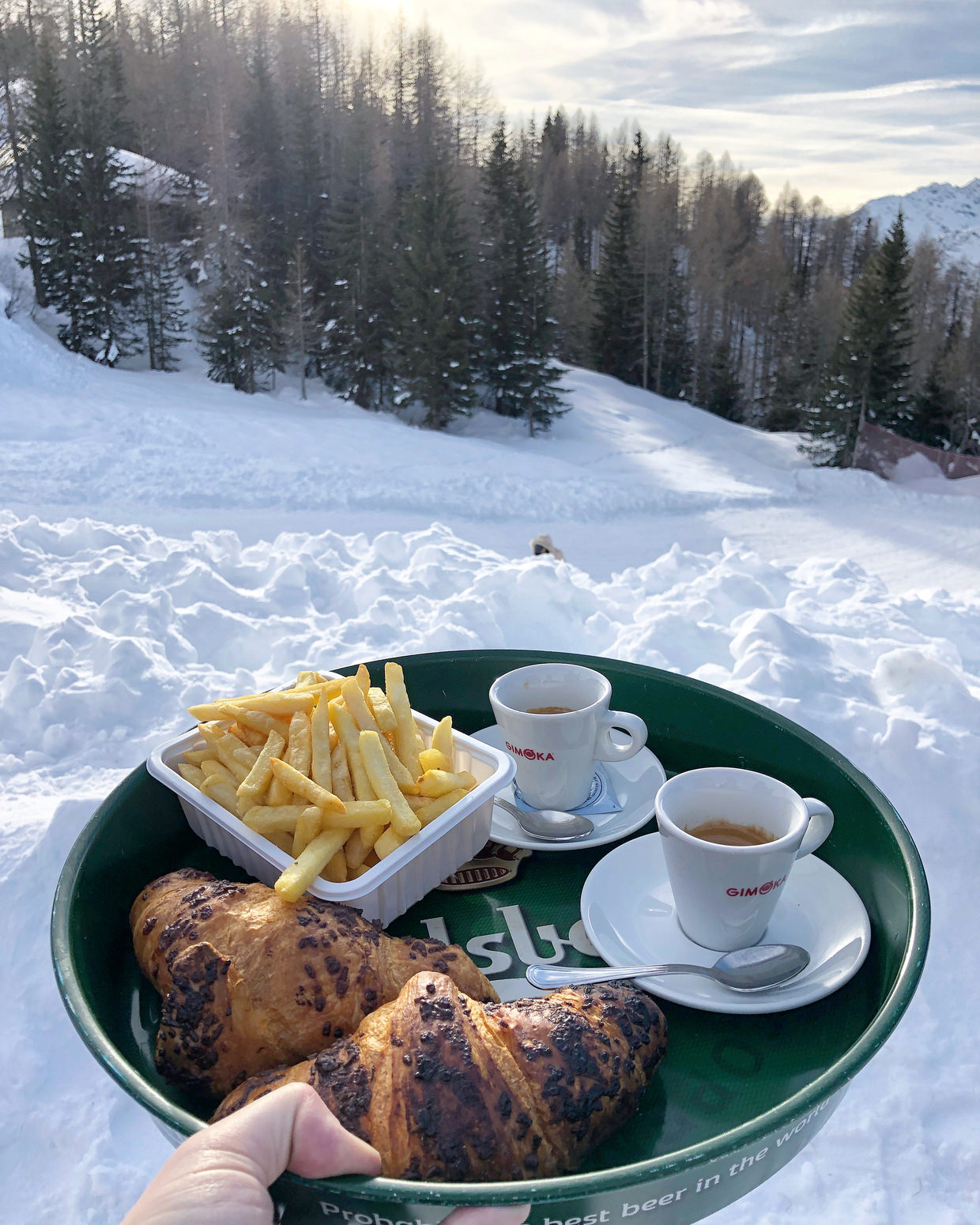 Croissants, coffee and chips in the snow