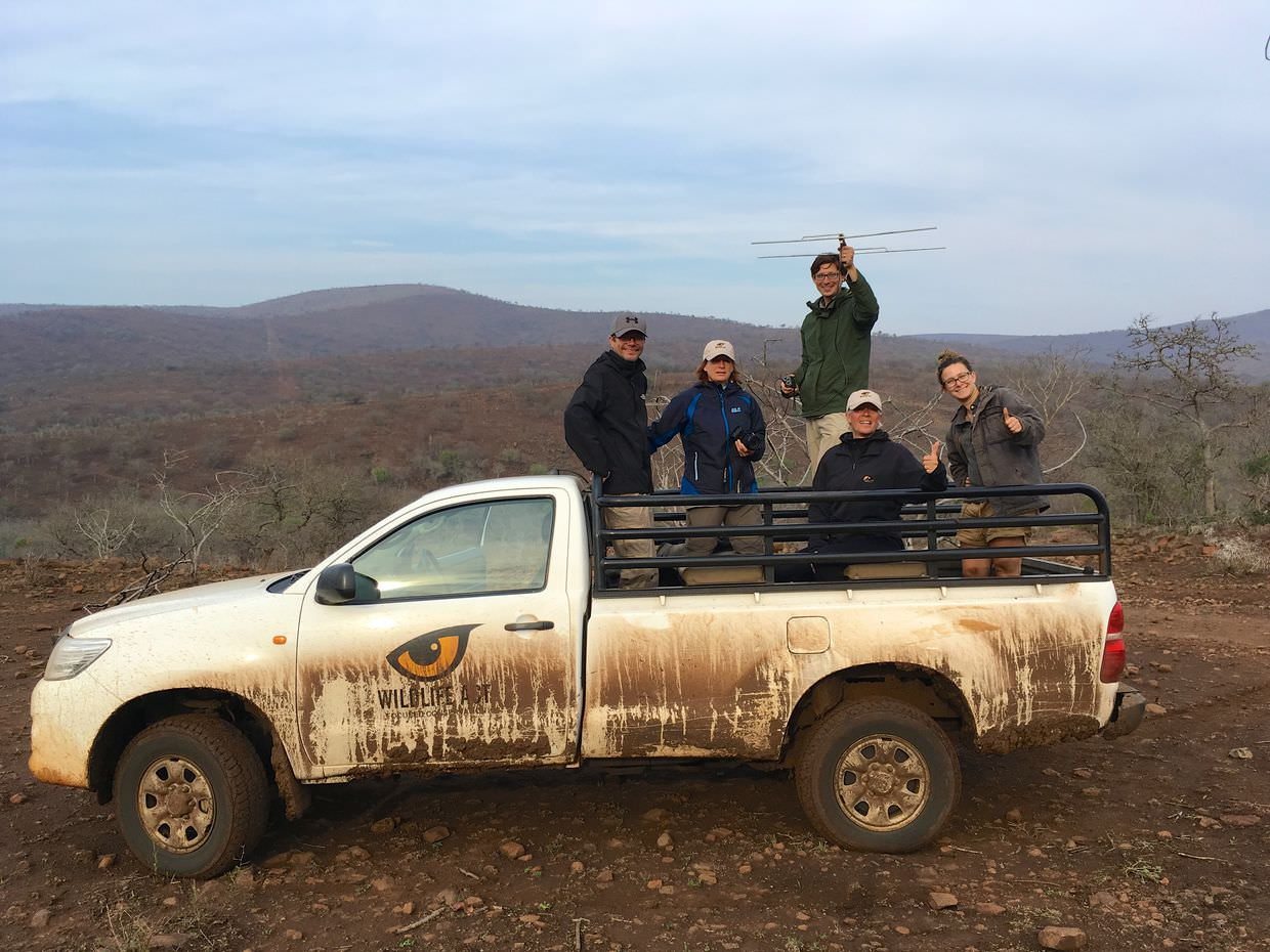 My group in our dirty white truck.Left to right: Paweł, Sylvia, Me (holding antenna), Babs and monitor Dani.