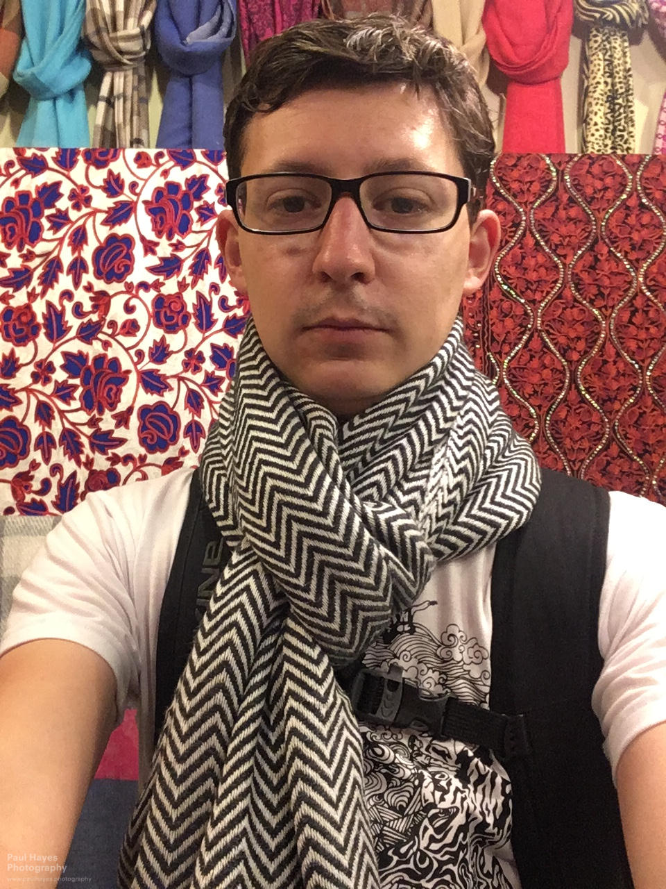 Paul trying on scarves